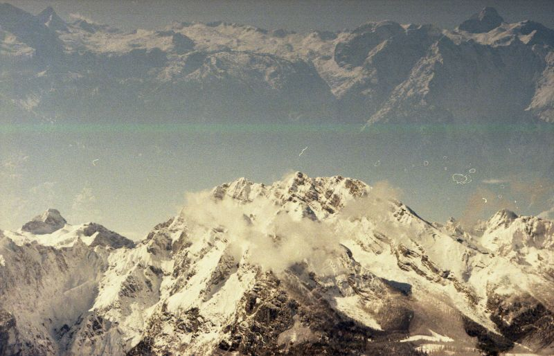 A double exposure of two snow covered mountain ranges.